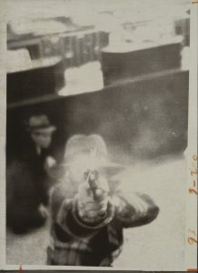 Bank Security Camera / Distributed by United Press International / Bank Robber Aiming at Security Camera, Cleveland, Ohio, March 8, 1975 / Gelatin silver print Image:67/8×413/16in / (17.4×12.2cm);Sheet:71/2×57/8in.(19.1×15cm) / The Metropolitan Museum of Art, Twentieth Century Photography Fund, 2015 (2015.278)