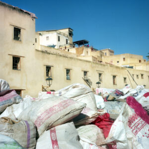 Bags of an unknown product piled high. Fez, Morocco.