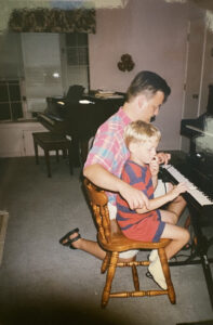 Cate's dad and brother at a piano.