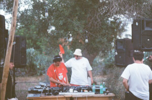 DJs and a sound system in nature background