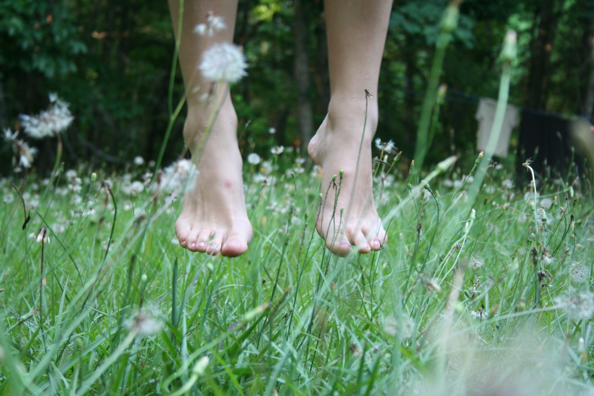 Bare feet floating in a field of wildflowers